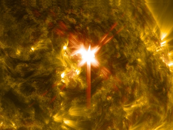 Extreme ultraviolet light streams out of an X-class solar flare as seen in this image captured on March 29, 2014, by NASA's Solar Dynamics Observatory. This image blends two wavelengths of light: 304 and 171 Angstroms, which help scientists observe the lower levels of the sun's atmosphere. Image Credit: NASA/SDO
