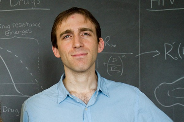 "Daniel Rosenbloom, a postdoctoral researcher in Harvard's Program for Evolutionary Dynamics, and colleagues provide the first evidence that the rock-paper-scissors dynamic can lead to higher mutation rates as organisms search for the next ""winning"" strategy. File photo by Jon Chase/Harvard Staff Photographer"