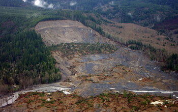 """The U.S. Geological Survey captured the upper parts of the landslide in Oso, Wash., in an aerial survey taken five days after this natural disaster killed 41 people. """"Active"""" search and rescue efforts were suspended this week as the community turned its attention to debris removal. Credit: Jonathan Godt, USGS"""