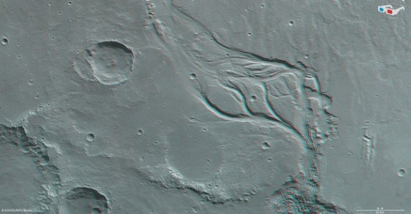 Data from the nadir channel and one stereo channel of the High Resolution Stereo Camera on Mars Express have been combined to produce this anaglyph 3D image, which can be viewed using stereoscopic glasses with red–green or red–blue filters. The image was created using data acquired on 7 December 2013 during orbit 12 624. The image resolution is about 17 m per pixel and the image centre is at about 15ºS / 322ºE. Copyright ESA/DLR/FU Berlin
