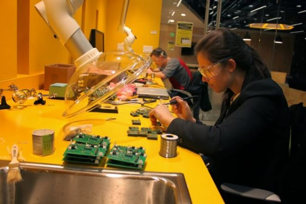 Katie Spies works on the internal wiring on a CLAIRITY node. Photo: Eben Cross