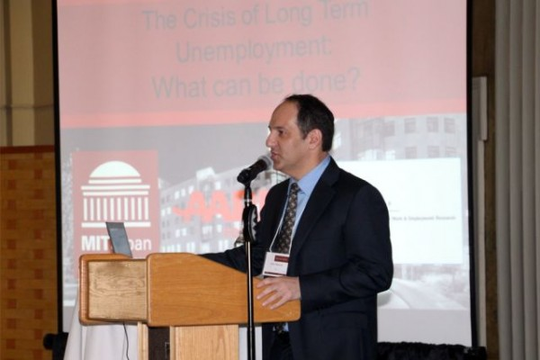 """MIT professor Ofer Sharone speaks at a conference, """"The Crisis of Long-Term Unemployment,"""" on May 6 at MIT. Photo: Robert Dolan"""