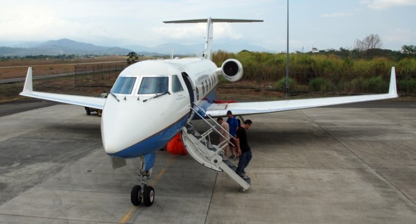 NASA's C-20A crew is shown preparing for flight from Tocumen International Airport in Panama City, Panama. The aircraft was deployed to Central and South America for a research study using JPL's UAVSAR located in an underbelly belly pod (note red cover). Image Credit: NASA / Stu Broce