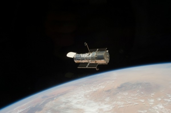 The Hubble Telescope as seen from NASA Space Shuttle STS-125 in May 2009. The Hubble Space Telescope was reborn with Servicing Mission 4 (SM4), the fifth and final servicing of the orbiting observatory. Image Credit: NASA