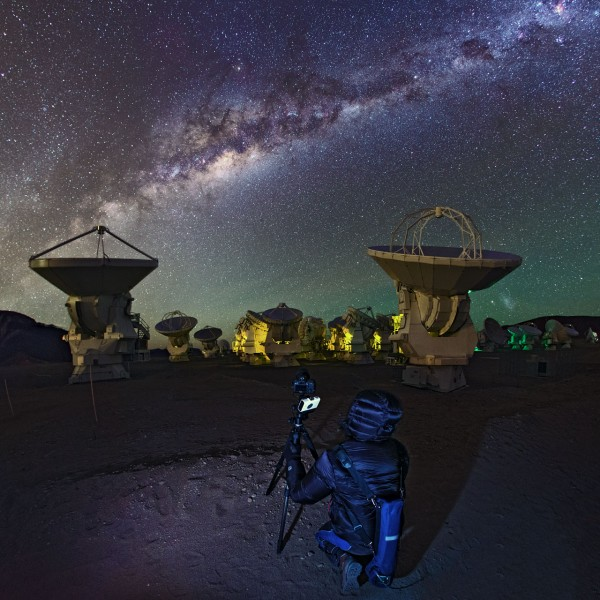 ESO Photo Ambassador, Babak Tafreshi took this photo of teammate Yuri Beletsky taking shots amongst the Atacama Large Millimeter/submillimeter Array (ALMA) during the the ESO Ultra HD Expedition.The Milky Way can be seen to stretch overhead.