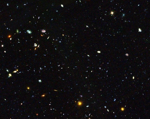 Hiding among these thousands of galaxies are faint dwarf galaxies residing in the early universe, between 2 and 6 billion years after the big bang, an important time period when most of the stars in the universe were formed. Some of these galaxies are undergoing starbursts. Image Credit: NASA and ESA