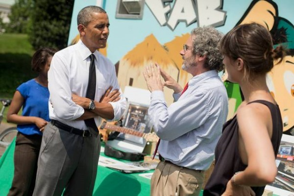 President Barack Obama talks with Neil Gershenfeld, director of MIT's Center for Bits and Atoms, as MIT graduate student Nadya Peek, right, looks on, during this week's White House Maker Faire. MIT's Mobile Fab Lab can be seen in the background. Photo: Pablo Martinez Monsivais, Associated Press (via MIT)