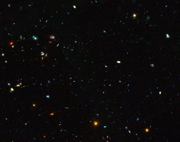 This image shows a region of space containing a sample of dwarf galaxies studied by the NASA/ESA Hubble Space Telescope to unlock the secrets of star formation in the early Universe. Hiding amongst these thousands of galaxies are faint dwarf galaxies that reside in the early Universe, between two and six billion years after the Big Bang, an important time period when most of the stars in the Universe were formed. Some of these galaxies are undergoing starbursts and have been studied by astronomers to deduce their contribution to star formation in this crucial era of the Universe's history. The image is part of the Great Observatories Origins Deep Survey (GOODS), and this image shows only one section that the survey covered.