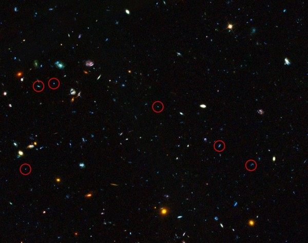 This image shows the area containing a sample of dwarf galaxies studied to unlock secrets of star formation in the early Universe. Highlighted are faint dwarf galaxies that reside in the early Universe, between two and six billion years after the Big Bang, an important time period when most of the stars in the Universe were formed. Some of these galaxies are undergoing starbursts and have been studied by astronomers to deduce their contribution to star formation in this crucial era of the Universe's history. The image is part of the Great Observatories Origins Deep Survey (GOODS), and this image shows only one section that the survey covered. Credit: Image credit: NASA, ESA, the GOODS Team and M. Giavalisco (STScI/University of Massachusetts) Acknowledgement: H.Atek (EPFL, Switzerland) and J-P.Kneib (EPFL, Switzerland)