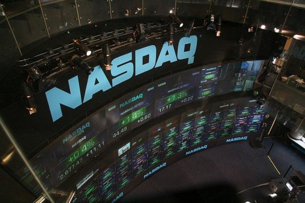 NASDAQ stock market displays at Time Square. Author: bfishadow on Flickr. Year: 2007.