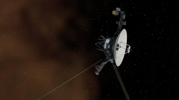 This artist's concept shows the Voyager 1 spacecraft entering the space between stars. The Voyager mission team announced in 2012 that the Voyager 1 spacecraft had passed into interstellar space, but some scientists say it is still within the heliosphere – the region of space domininated by the Sun and its wind of energetic particles. In a new study, two Voyager team scientists are proposing a test that they say could prove once and for all of Voyager 1 has crossed the boundary. Credit: NASA/JPL-Caltech