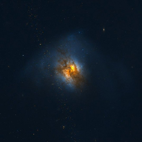 Arp220, a nearby 'Ultraluminous Infrared Galaxy' similar to what ALESS65 would look like if it were closer to Earth. Credit: NASA, ESA, and the Hubble Team.