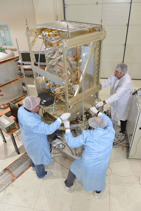 French space agency engineers working on the Pharao atomic space clock. Pharao is part of the Atomic Clock Ensemble in Space, ACES, that will fly to the International Space Station in 2016. Copyright CNES