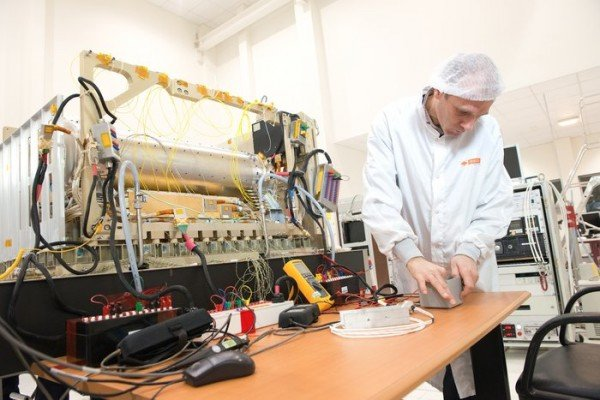 A technician tests the Pharao atomic space clock. Pharao is part of the Atomic Clock Ensemble in Space, ACES, that will fly to the International Space Station in 2016. Delivered by France's CNES space agency, Pharao is accurate to a second in 300 million years. This will allow scientists to test fundamental theories first proposed by Albert Einstein to an accuracy that is impossible in laboratories on Earth. To achieve its accurate timekeeping, the Pharao space clock uses lasers to cool caesium atoms down to  –273°C, close to absolute zero. The final 375 kg experiment will be installed on a platform outside Europe's Columbus space laboratory. Copyright CNES–S. Girard, 2014