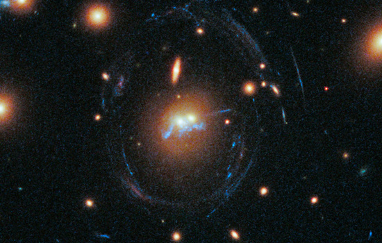 The NASA/ESA Hubble Space Telescope captured a cosmic moment of two merging cluster galaxies connected by a bright blue string of young stars. Credit: NASA, ESA and RIT