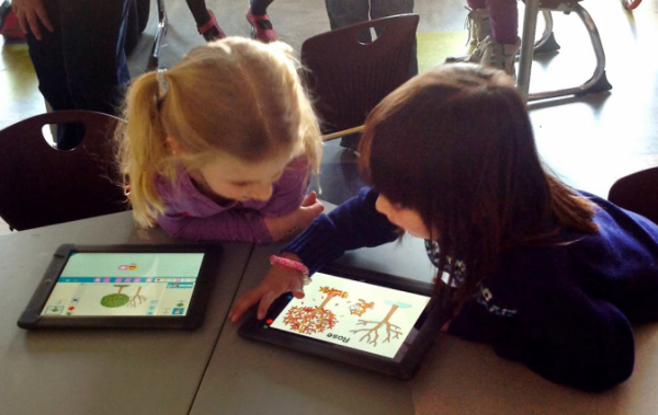 With ScratchJr, young children (ages 5-7) learn important literacy skills as they program their own interactive stories and games. Photo: Amanda Strawhacker and Dylan Portelance/Tufts University