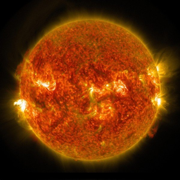 A bright solar flare can be seen on the left side of the sun in this image captured by NASA's Solar Dynamics Observatory on Aug. 24, 2014. Image Credit: NASA/SDO