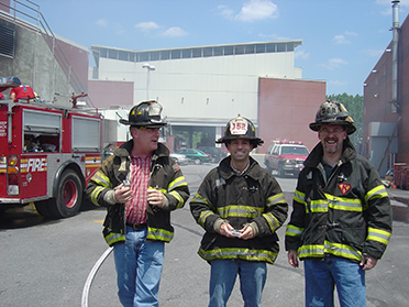"""David DeRieux (right) of the U.S. Naval Research Laboratory (NRL) invented a system for Fire Department New York to automatically track firefighters. The requirements? """"It has to be easy to use, reliable, and cheap,"""" says George Arthur (left).  (Photo: U.S. Naval Research Laboratory)"""