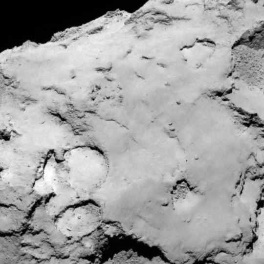 This image shows a zoom into candidate site C, which is located on the larger lobe of the comet. It hosts a range of surface features including some brighter material, depressions, cliffs, hills and smooth plains, but higher-resolution imaging is needed to assess the risk of some of these features. It is also well illuminated, which would benefit the long-term scientific planning for Philae. Credit: ESA/Rosetta/MPS for OSIRIS Team MPS/UPD/LAM/IAA/SSO/INTA/UPM/DASP/IDA