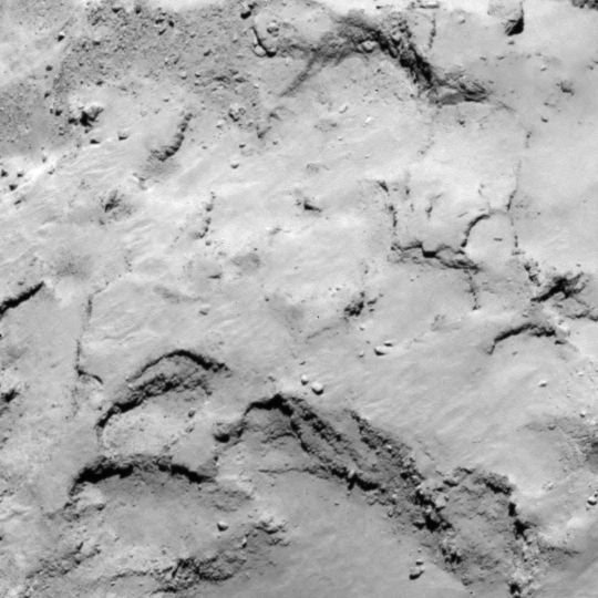 This image shows a zoom into candidate site J, on the smaller lobe of the comet. Similar to site I, this site also offers interesting surface features and good illumination. It offers advantages for the CONSERT experiment compared with I, but higher-resolution imaging is needed to determine the details of the terrain, which shows some boulders and terracing. Credits: ESA/Rosetta/MPS for OSIRIS  Team MPS/UPD/LAM/IAA/SSO/INTA/UPM/DASP/IDA