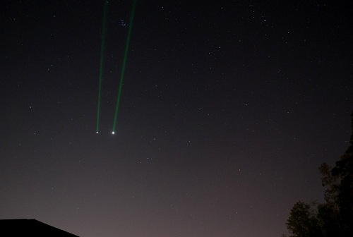 Earth strikes back… firing a 5mw green laser at the 2013 conjunction of Jupiter and Venus. Photo by author.