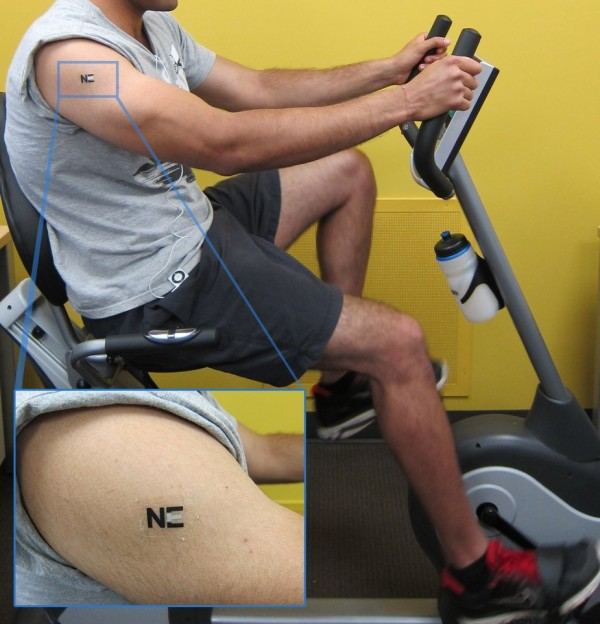 A tattoo biosensor (enlarged above) detects lactate levels during exercise; a biobattery using the technology could power electronics. Photo credit: Joe Wang, ACS