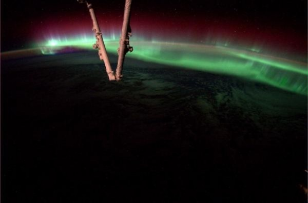 An aurora dances in the atmosphere on Aug. 20, 2014, as the International Space Station flew over North America. This image was captured by astronaut Reid Wiseman from his vantage point on the ISS. Image Credit: NASA