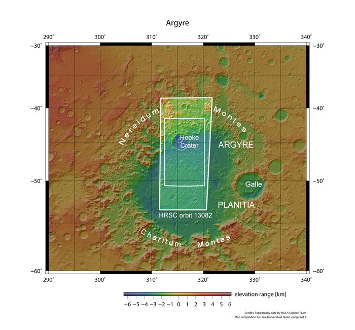 Hooke crater is located at about 46°S / 316°E, near the northern edge of the 1800 km-wide Argyre basin, one of the most impressive impact structures on Mars. The crater, with diameter 138 km and a maximum depth of about 2.4 km, is situated in a flat region within the basin known as Argyre Planitia. The region was imaged by the High Resolution Stereo Camera on Mars Express on 20 April 2014 during orbit 13 082. The smaller rectangle above outlines the region highlighted in the associated Mars Express images. Copyright NASA MGS MOLA Science Team