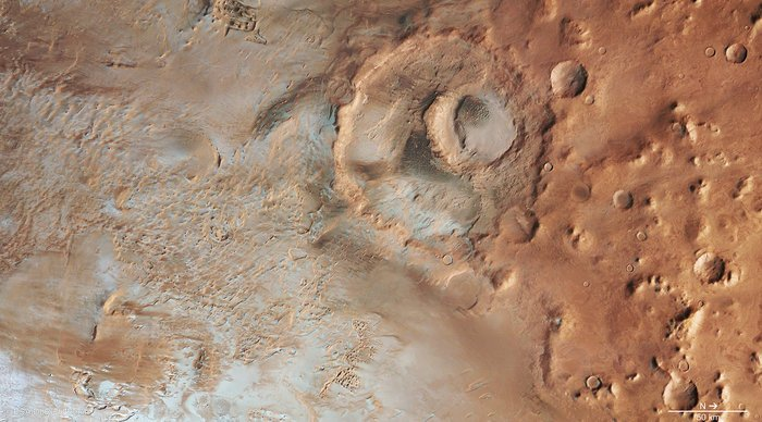 Hooke crater is located near the northern edge of the 1800 km-wide Argyre basin, one of the most impressive impact structures on Mars, excavated in a giant collision about 4 billion years ago. Copyright ESA/DLR/FU Berlin