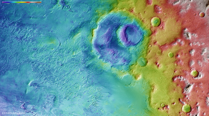Colour-coded topography map of a region of the Argyre basin, featuring Hooke crater and part of the floor of the basin known as Argyre Planitia. White and red show the highest terrains, while blue and purple show the deepest. The image is based on a digital terrain model of the region, from which the topography of the landscape can be derived. The region clearly slopes to the south (left). Copyright ESA/DLR/FU Berlin