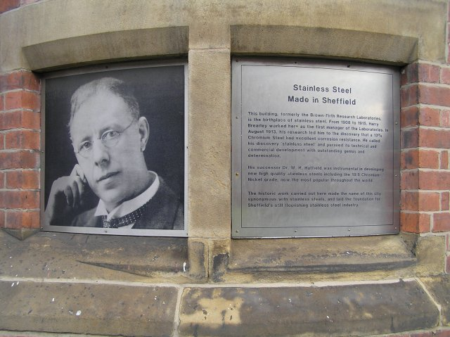 Monument to metallurgist Harry Brearley, who in 1913 discovered that chromium added to steel gave it enhanced corrosion protection, which became known as 'stainless steel'. The chromium in the steel reacts with oxygen in the air to form an invisible protective and self-healing chromium oxide layer in place of the more usual iron oxide, better known as rust. Copyright Wikimedia Commons–David Morris