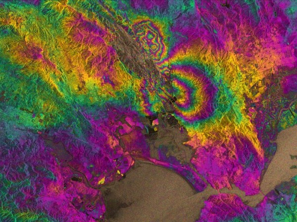 The biggest earthquake in 25 years struck California's Napa Valley in the early hours of 24 August 2014. By processing two Sentinel-1A images, which were acquired on 7 August and 31 August 2014 over this wine-producing region, an interferogram was generated. The two round shapes around Napa valley, which are visible in the central part of the image show how the ground moved during the quake. Deformation on the ground causes phase changes in radar signals that appear as the rainbow-coloured patterns. Each colour cycle corresponds to a deformation of 28 mm deformation. The maximum deformation is more than 10 cm, and an area of about 30x30 km was affected significantly. Interferograms like these are being used by scientists on the ground to help them map the surface rupture and model the earthquake. This interferogram very clearly shows the fault that caused the earthquake, which had not been identified as being particularly hazardous prior to the event. Despite this interferogram being computed with images acquired in the satellite's 'stripmap mode', which is not going to be the default mode when operational, this result demonstrates the capability of Sentinel-1A and marks the beginning of a new era for our ability to map earthquakes from space. Copyright Copernicus data (2014)/ESA/PPO.labs/Norut/COMET-SEOM Insarap study