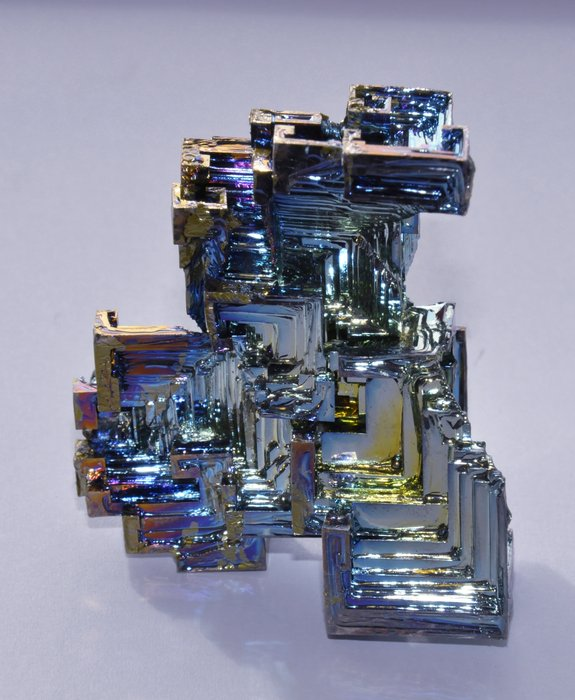 Semi-metallic bismuth crystal, used in thermoelectric compounds and special bearing alloys. Copyright ESA