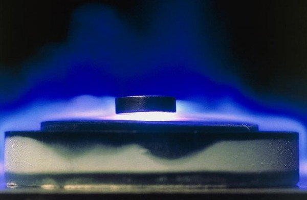 Magnetic levitation of a high-temperature 'cuprate' superconductor, caused by the Meissner effect, which causes the magnetic flux to be expelled from a superconductor. Copyright Birmingham University