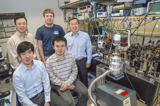 (Clockwise from lower left) Ziliang Ye, Xiang Zhang, Kevin O'Brien, Steven Louie and Ting Cao discovered excitonic dark states in monolayers of a 2D TMDC material that hold important implications for future nanoelectronic and photonic applications. (Photo by Roy Kaltschmidt)