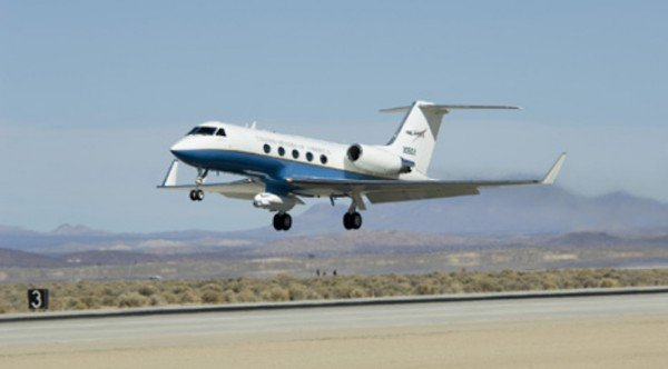 NASA's C-20A Earth science research aircraft with the UAVSAR slung underneath its belly lifts off the runway at Edwards Air Force Base on a prior radar survey mission. Image Credit: NASA Armstrong