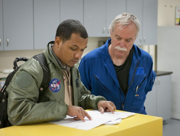 NASA's Matt Berry (left), a flight operations engineer at NASA's Armstrong Flight Research Center, reviews the flight plan with Principal Investigator Bruce Anderson. Image Credit: NASA / Tom Tschida