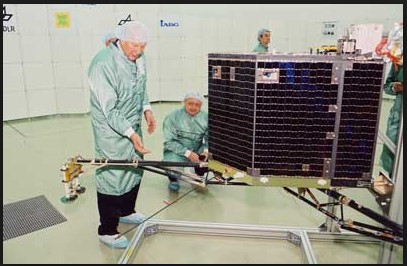 Clean Room photo of Philae with Principal Investigator Dr. Helmut Rosenbauer, Director at the Max-Planck-Institute for Aeronomy. Philae's mass is 100 kg including 21 kg of instrument payload It's dimensions are 1 × 1 × 0.8 meters (3.3 × 3.3 × 2.6 ft) Photo Credit: Max Planck Institute, Filser)