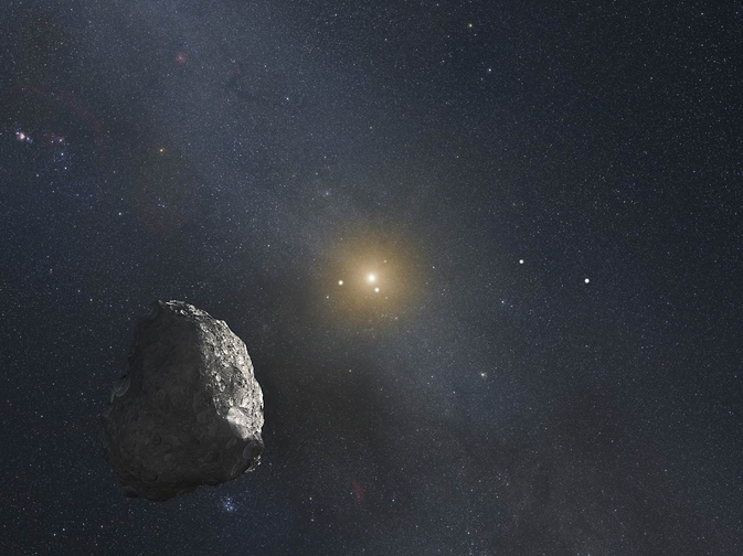 This is an artist's impression of a Kuiper Belt object (KBO), located on the outer rim of our solar system at a staggering distance of 4 billion miles from the Sun. A HST survey uncovered three KBOs that are potentially reachable by NASA's New Horizons spacecraft after it passes by Pluto in mid-2015. Image Credit: NASA, ESA, and G. Bacon (STScI)