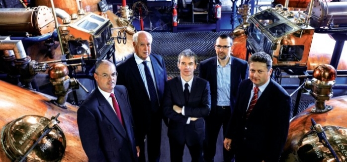 Believers: Tangney (center) poses in the Tullibardine Distillery with (from left) then-managing director Doug Ross, Ward, Zero Waste Scotland Director Iain Gulland, and Simmers in 2012. Credit: Celtic Renewables