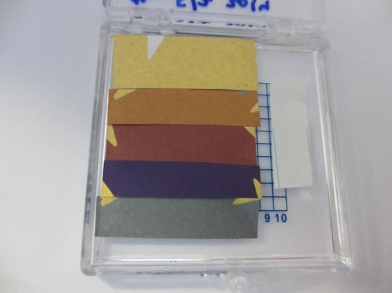These are gold-coated notebook paper pieces with ultra-thin germanium films of different thickness deposited on top. Credit: M. Kats / Harvard