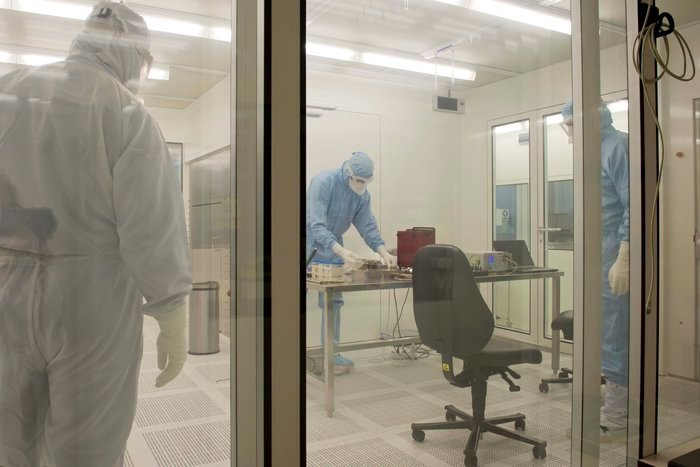 ESA's ultra-clean microbiology laboratory is part of the Agency's Life, Physical Sciences and Microgravity Laboratory, based in Noordwijk, the Netherlands. The air on the other side of the glass is an ISO class 1 cleanroom, its rigorously filtered air containing at rest millions of times fewer particles than the outside atmosphere: fewer than a dozen particles larger than 0.1 micrometres, such as a speck of dust,  per cubic metre of air. This makes it suitable for Planetary Protection procedures, such as examining temperature sensors destined to end up on the surface of Mars aboard the ExoMars 2016 Schiaparelli lander. Copyright ESA–A. Le Floc'h