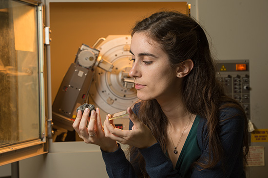 Kellie Wall, a senior from Port Orchard, Wash., has an article in Nature Communications detailing a new method for finding water on Mars. She did much of her analysis with the x-ray diffractometer in WSU's geoanalytical laboratory. (Photo by Robert Hubner, WSU Photo Services)