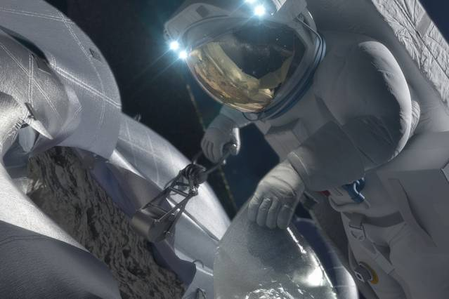 This concept image shows an astronaut retrieving a sample from the captured asteroid. Courtesy of NASA