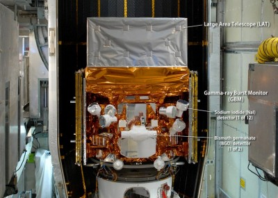 This image of NASA's Fermi Gamma-ray Space Telescope, shown here in May 2008 being readied for launch, highlights the spacecraft's instruments. The Gamma-ray Burst Monitor (GBM) is an array of 14 crystal detectors sensitive to short-lived gamma-ray blasts. Image Credit: NASA/Jim Grossmann