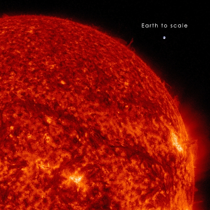 A dark snaking line in the upper right of the sun in this image on Sept. 30, 2014, shows a filament of solar material hovering above the sun's surface. NASA's SDO captured the image in extreme UV light. The Earth is shown to scale. Image Credit: NASA/SDO