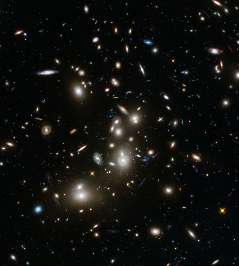 This image of Abell 2744 is the first to come from Hubble's Frontier Fields observing programme, which is using the magnifying power of enormous galaxy clusters to peer deep into the distant Universe. Abell 2744, nicknamed Pandora's Cluster, is thought to have a very violent history, having formed from a cosmic pile-up of multiple galaxy clusters. Abell 2744 is the first of six targets for an observing programme known as Frontier Fields. This three-year, 840-orbit programme will yield our deepest views of the Universe to date, using the power of Hubble to explore more distant regions of space than could otherwise be seen, by observing gravitational lensing effects around six different galaxy clusters. Credit: NASA, ESA, and J. Lotz, M. Mountain, A. Koekemoer, and the HFF Team (STScI).