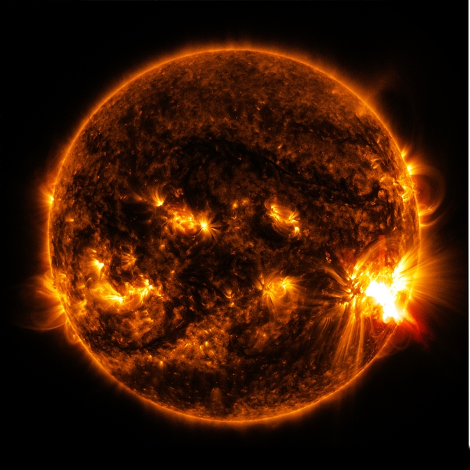 NASA's Solar Dynamics Observatory captured this image of an X-class solar flare bursting off the lower right side of the sun on Oct. 27, 2014. The image shows a blend of extreme ultraviolet light with wavelengths of 131 and 171 Angstroms. Image Credit: NASA/SDO