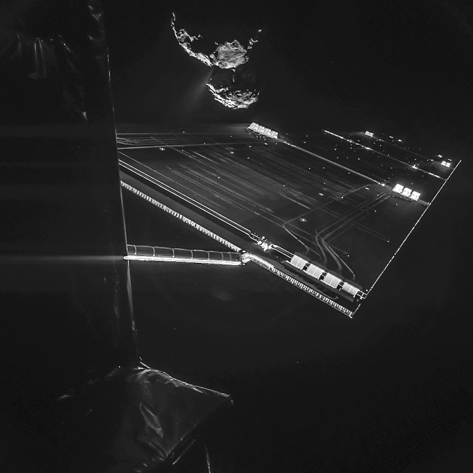 A composite image from a camera on the Rosetta mission's Philae comet lander shows a solar array, with comet 67P/Churyumov–Gerasimenko in the background. Image Credit: ESA/Rosetta/Philae/CIVA