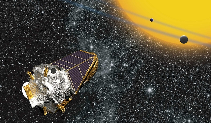 Artist's conception of the Kepler space telescope observing planets transiting a distant star. Image Credit: NASA Ames/ W Stenzel